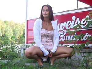 Tanned slender babe lifts her short dress