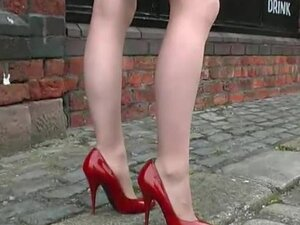 Sexy high heeled woman walking on cobbles wearing