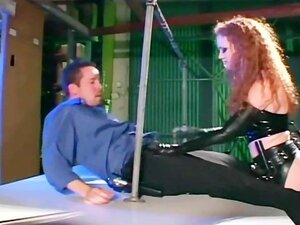 Redhead in a cop uniform sexy latex gloves and a