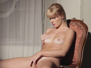 Charlise Bella undresses for a hot erotic