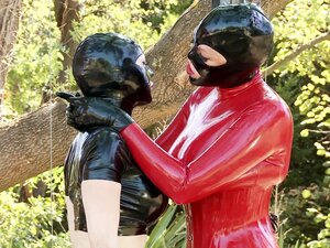 Tight and shiny latex on two kinky lesbians