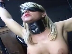 Blonde bitch with a nipple needle is dominated,