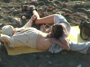 Voyeur Couple On Beach,