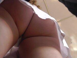 Cute babe with chubby ass gets an upskirt