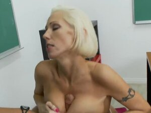 Mature blond hottie Kasey Grant with big fake tits