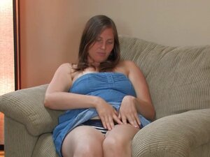 Hairy Lindsay plays with her wet pussy hairs on