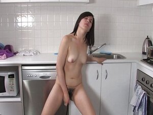 Girls Out West - Hairy cutie in the kitchen