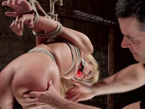 Busty blonde slave whipped and gagged