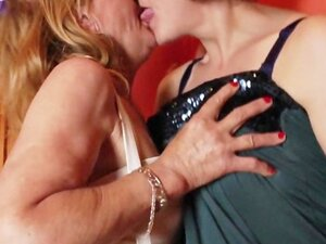 Mature dykes stripping and kissing