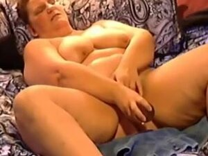 Amateur SSBBW wife in bed using a huge sex tool