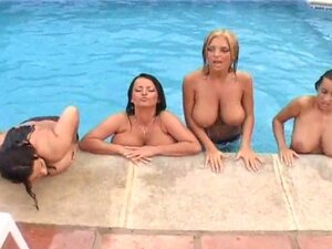 Four chicks with huge boobs swim in a pool and
