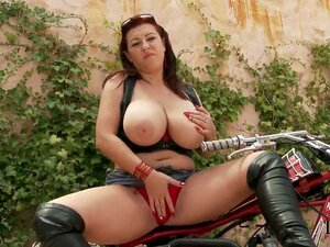Full figured biker chick Kora with long red nails