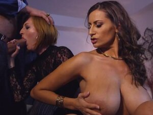 Flamboyant brunette with large boobs rides the
