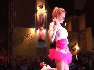 Hot busty redhead girl pushing her huge