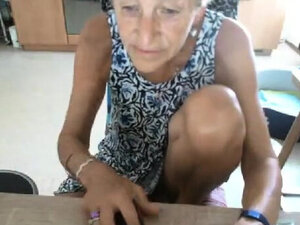 Blonde granny masturbate on the chair in