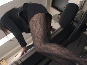 Seductive Asian office girl in a sexy pantyhose