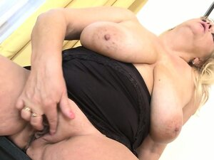 Old mature with big boobs plays with herself in