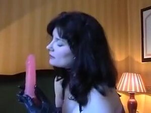 Hot brunette milf wife with big tits plays with a
