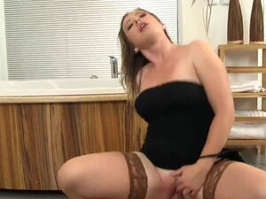 Staggered model in lingerie is geeting peed on and