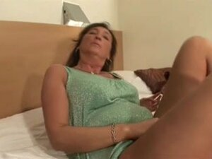 Old and horny bitch dancing erotically on the bed