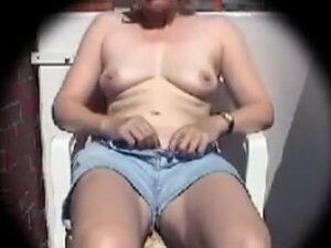 older wife masturbates on her balcony during the