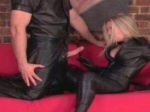 Humiliated sex slave in black leather fucks her