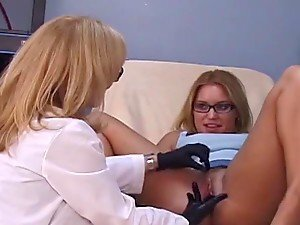 Female doctor fingers and toys her patient in a