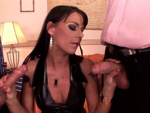 Slut in leather services two cocks and does a