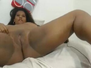 Fat black colombian girl showing off her milkers &