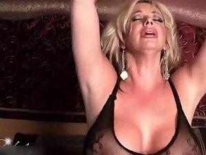 Busty milf blonde sat on a sex machine
