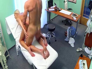 Busty blonde having fun with the doctor