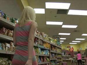Sweet teen blonde finds a banana at the store to