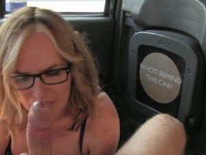 Mature passenger rims taxi driver