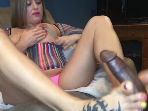 Big tits chick gives an amazing footjob on BBC,