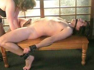 BBW Mature gives submissive slave a slow handjob,