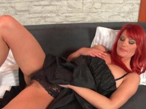 Redhead milf works her hairy pussy