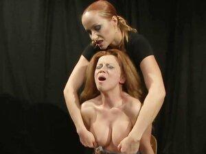 Lezdom fingers slave after spanking her