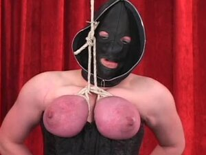 Hood and corset on bound girl
