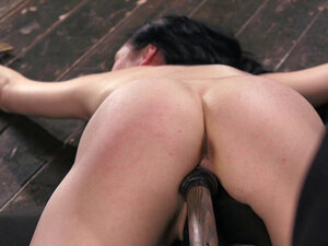 Shackled brunette pussy fucked with toy