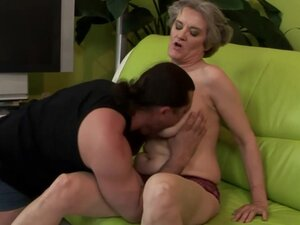 Granny on couch gives blow and titjob before