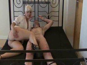 Mistress Nurse uses  sounds on her bound slave