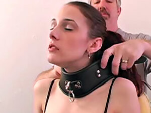 He puts pretty girl in thick leather collar