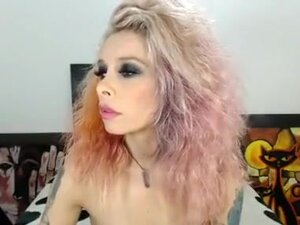 Punk woman struts her material on cam,