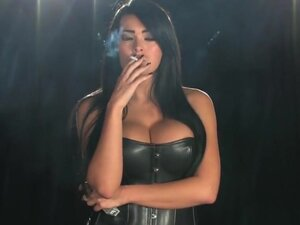 Smoking brunette in leather basque,