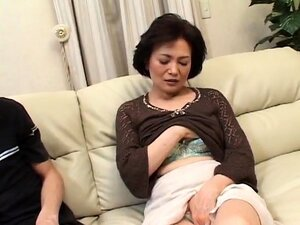 Horny Japanese mom has a young guy fulfilling her