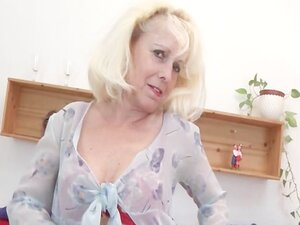 Sexy mature babe strips to masturbate pussy