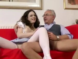 Glamorous brunette riding old man