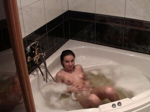 Lizzie masturbating in a jacuzzi