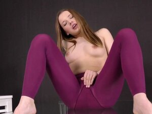 Brunette in purple pantyhose gets all wet
