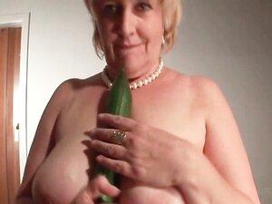 Stockinged mature masturbates with a cucumber